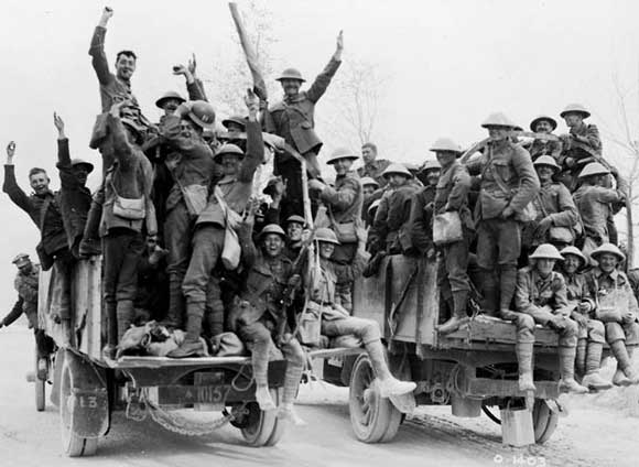Happy Canadians who captured Vimy Ridge returning to rest billets on motor lorries.