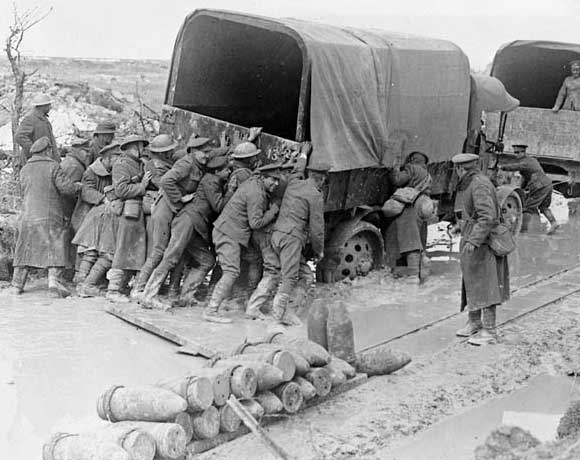Canadians giving a lorry a helping hand on a shell battered road on Vimy Ridge.