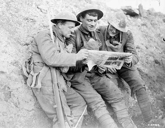 Canadians interested in the Canadian Daily Record in trenches near Lens.